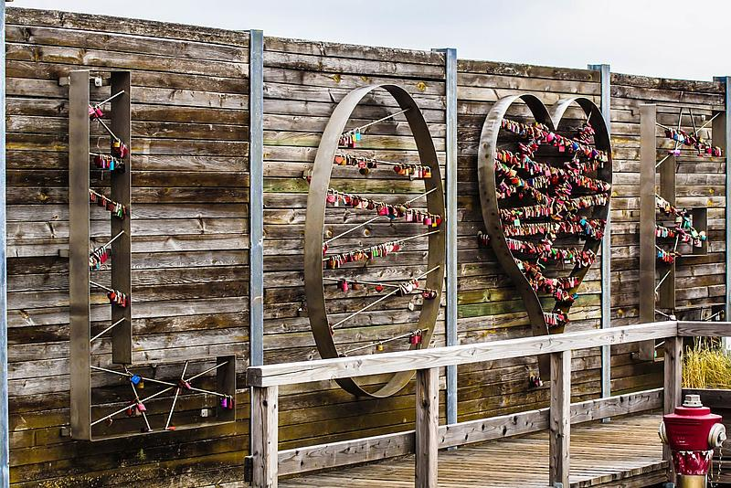 LOVE sign with padlocks at the harbour of List